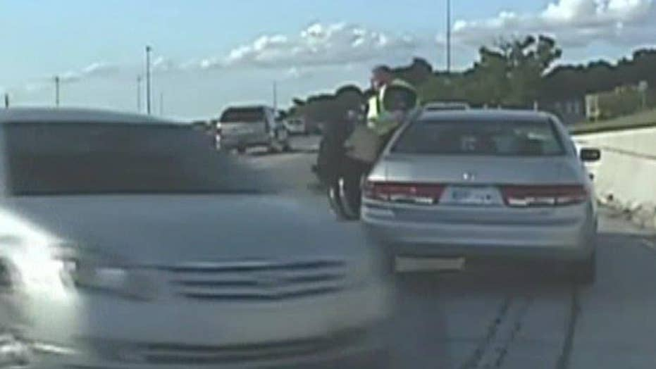 Cop narrowly avoids getting crushed by car