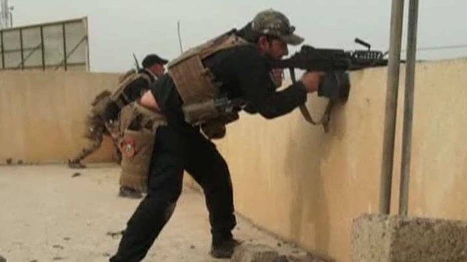 Iraqi special forces pause in Mosul due to bad weather