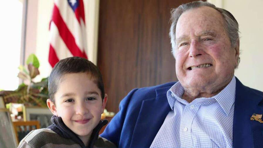 Former president's heartwarming reunion with son of member of his security detail