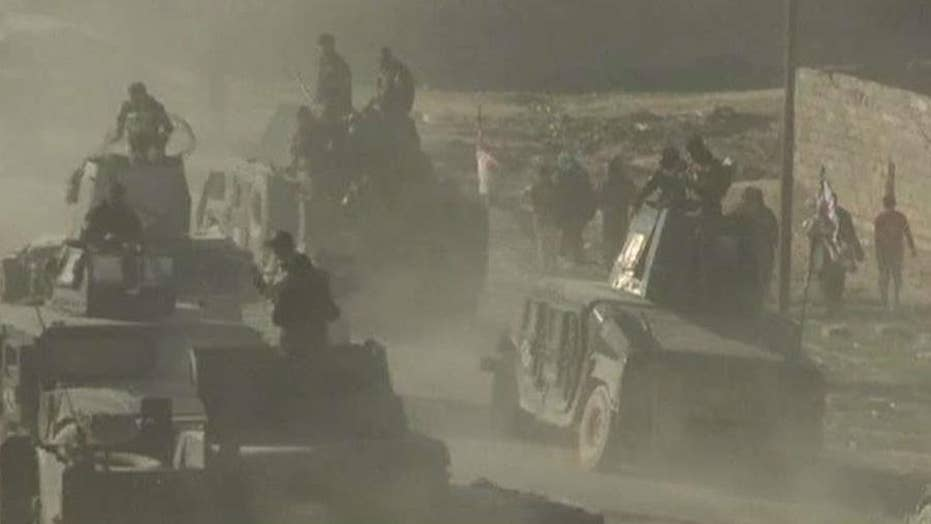 Iraqi forces advance through intense fighting in Mosul
