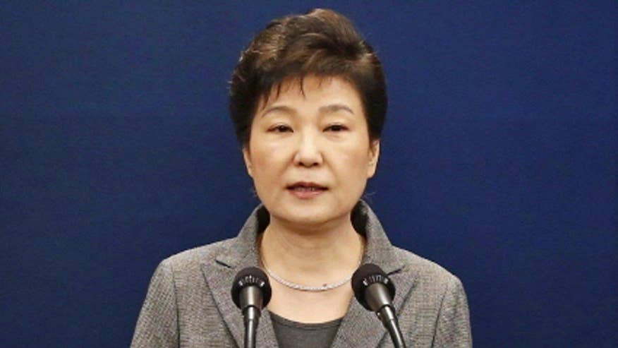 President Park Geun-hye says she will step down once parliament develops plan for safe transfer of power