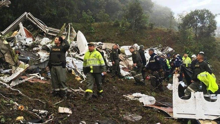Investigators recover the black boxes from the fatal crash of a charter plane in Colombia