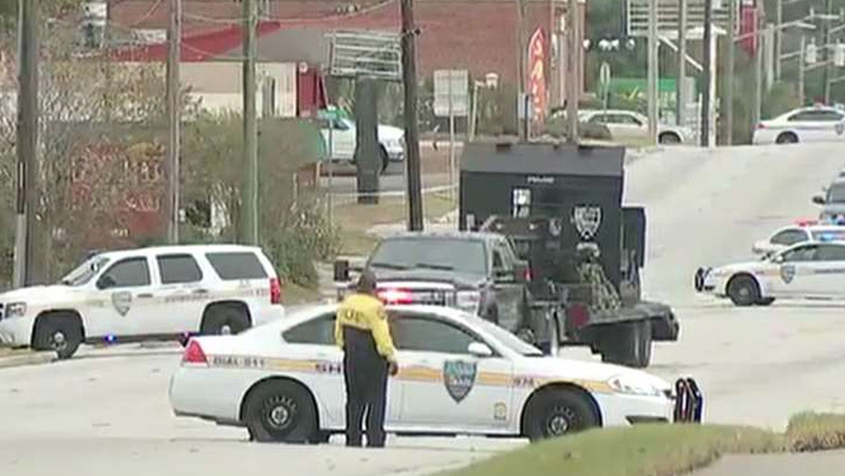 Report: Hostages freed, armed bank robber surrenders