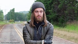 "Tom Payne of AMC's ""Walking Dead"" tells FNM he doesn't think he'd last too long in a zombie apocalypse. Find out why - and find out Payne's crazy hometown connection to Andrew Lincoln - in his exclusive FNM interview."