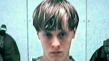 Judge grants Dylann Roof's request to hire back lawyers