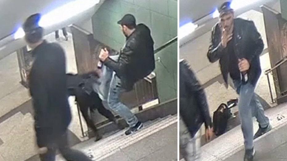 Man kicks woman down stairs at train station