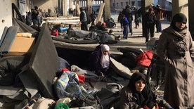 Pro-government forces close in on the last rebel enclave in Syrian city