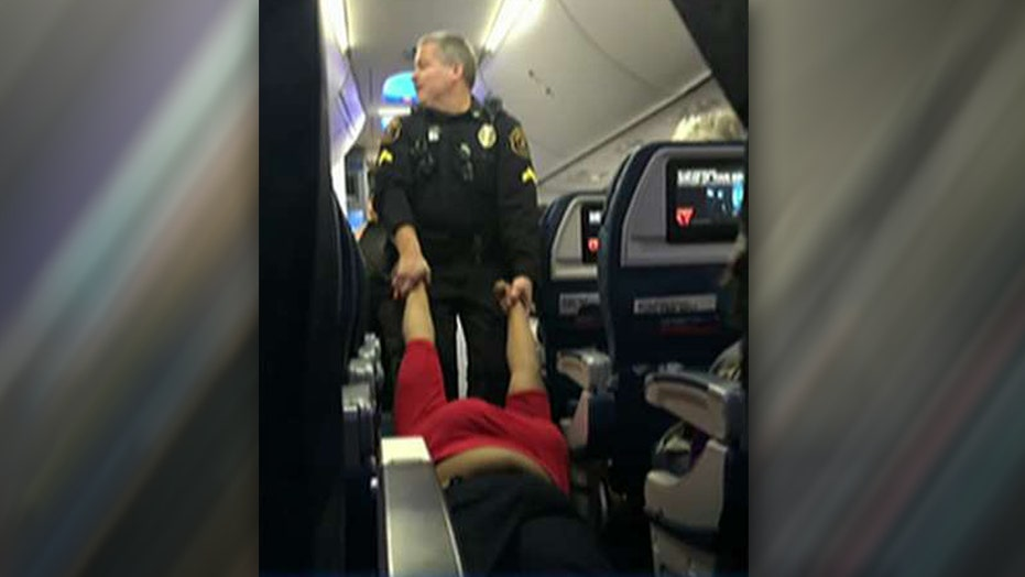 Woman arrested, dragged off plane like ragdoll