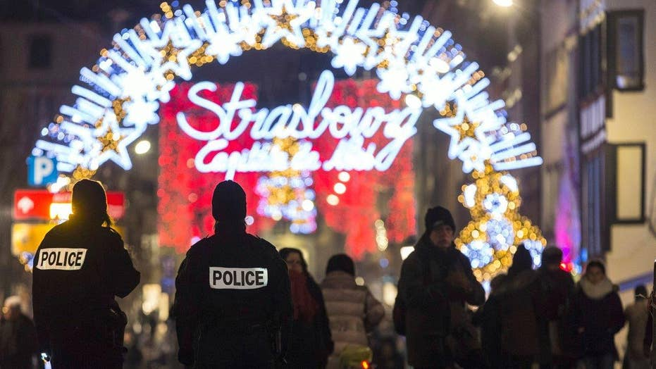 Berlin on edge as hunt for truck attack driver continues