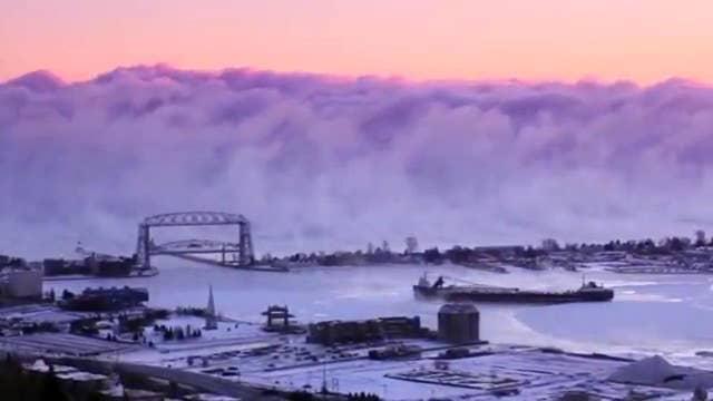 Amazing video shows 'sea smoke' rolling through harbor