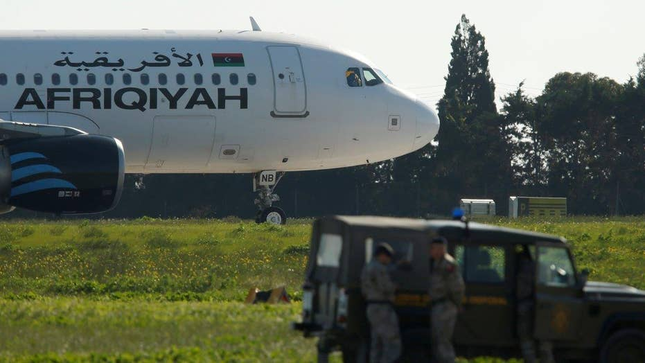 Hijackers of Libyan airplane surrender after standoff