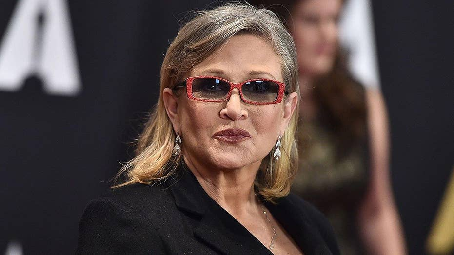 Reports: Carrie Fisher suffers heart attack on flight