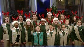 Scouts spread Christmas cheer with music