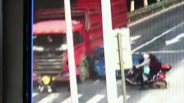 Toddler walks away after stroller is hit by truck