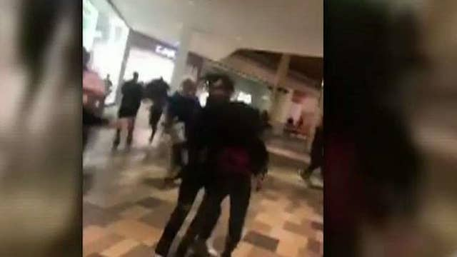 Pandemonium at nation's malls leads to fights, stampedes