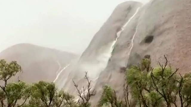 Flashfloods create waterfalls in Australia's iconic park