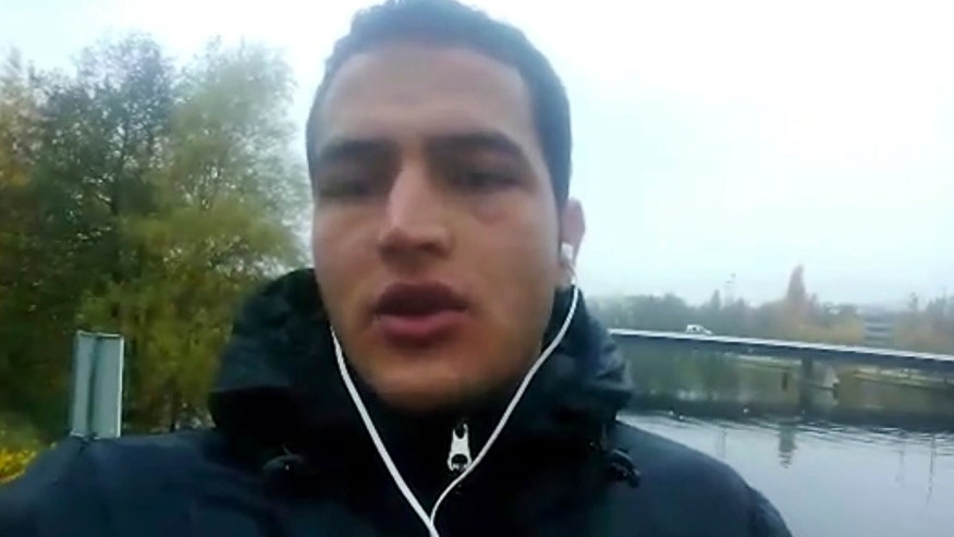 Footage shows Anis Amri boarding train to Milan, Italy where he was shot by police