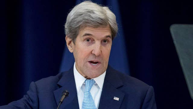 Kerry defends decision to let UN resolution pass