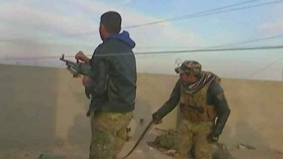 Iraqi troops push deeper into city of Mosul