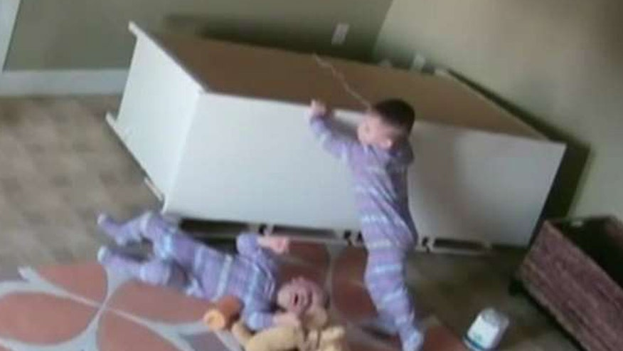 Two-year-old moves dresser enough for brother to crawl out