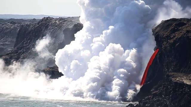 'Fire hose' of lava pours into ocean