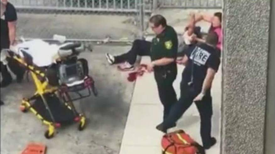Raw video: First responders attend to victim of shooting at Fort Lauderdale-Hollywood International Airport