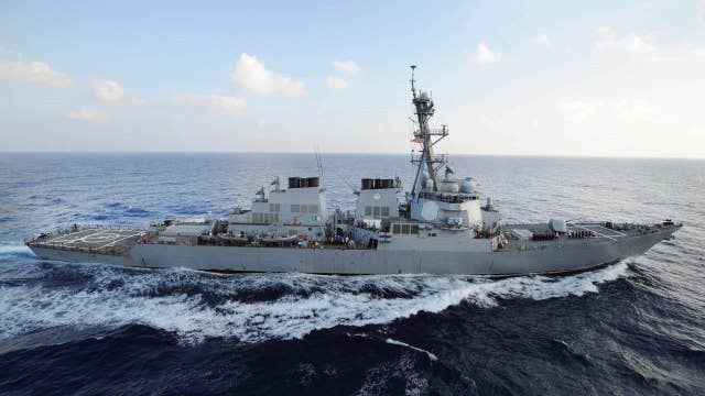 US Navy destroyer warns Iranian vessels
