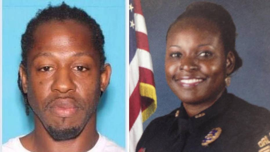 Massive manhunt for suspect in shooting death of Florida cop