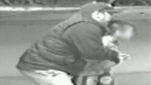 Photos show man trying to abduct child at wrestling event
