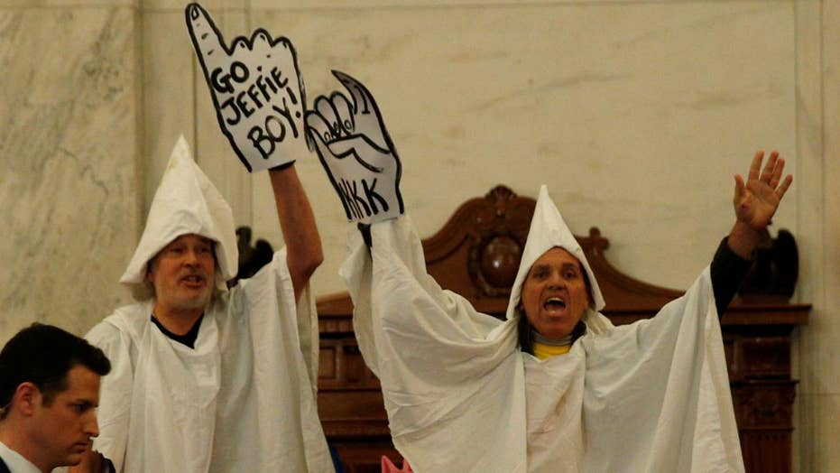 Men in KKK costumes interrupt Sessions confirmation hearing