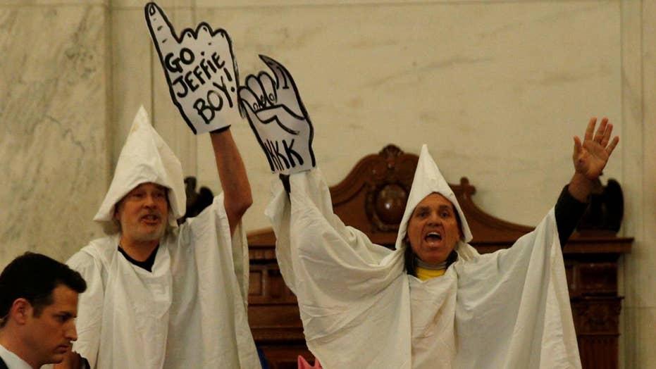 Men in KKK costumes interrupt Sessions confirmation hearing
