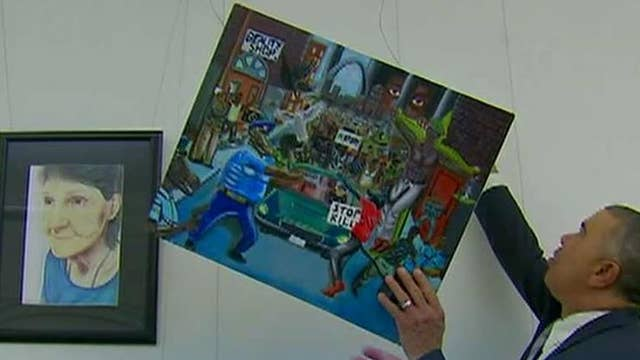 Dems rehang controversial 'pigs' painting on Capitol Hill