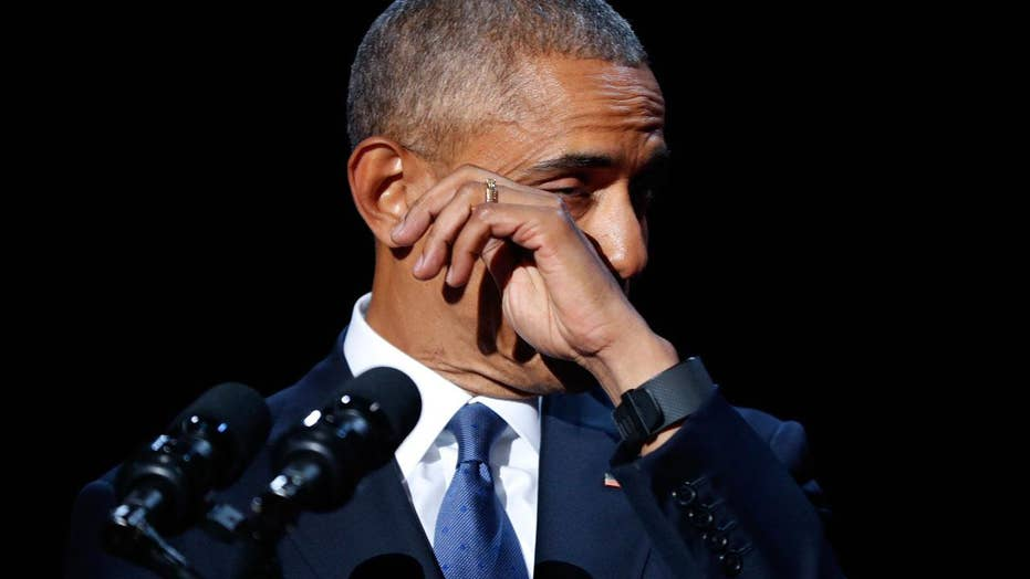 An emotional President Obama salutes family, Biden and staff