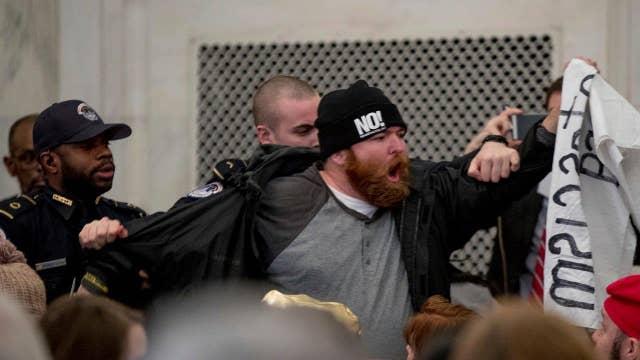 Protestors crash confirmation hearings for Trump's Cabinet