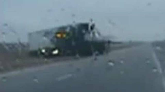 Cop's split-second move avoids head-on collision with truck
