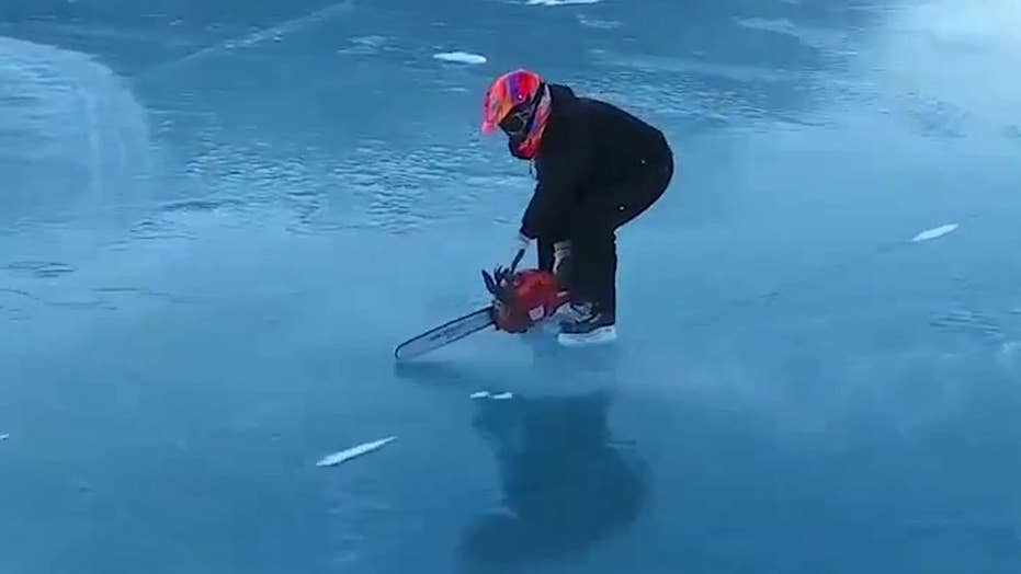 Ice skater uses chainsaw to zip across frozen lake