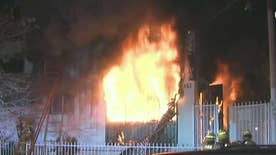 Four children plucked from burning home in Los Angeles