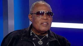 Singer tells Tucker he will take Holliday's place and perform at Trump's inauguration, explains why he doesn't think Rep. John Lewis is a 'true' civil rights icon