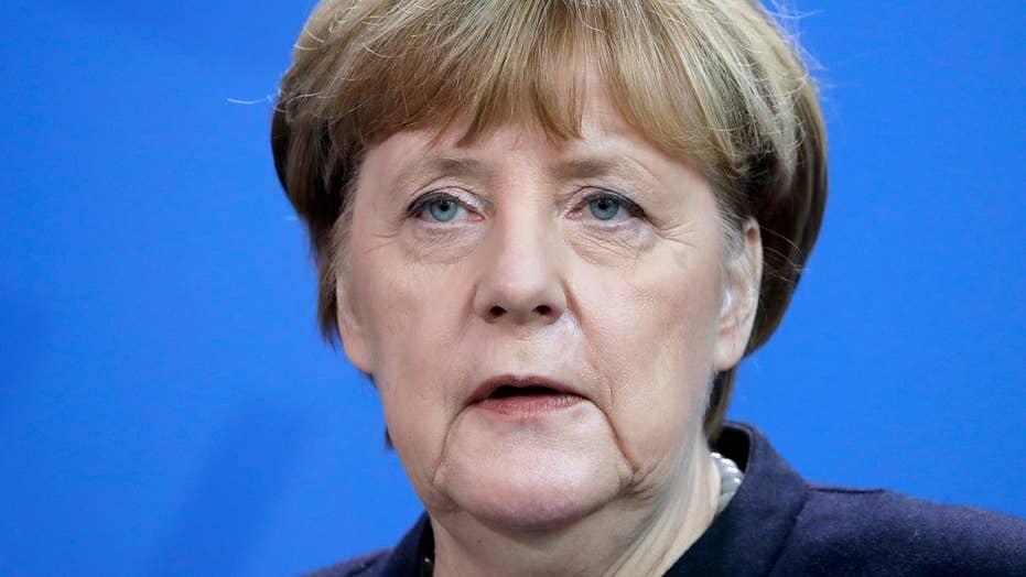 Trump says Merkel made 'catastrophic mistake' on refugees
