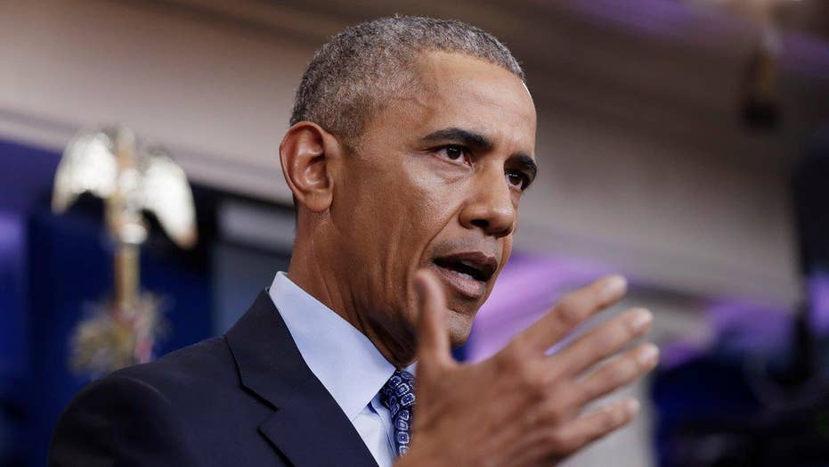 Obama says he is very comfortable with his Manning decision