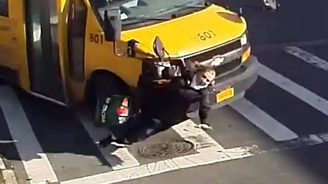 Warning, graphic video: Woman knocked down, run over by bus