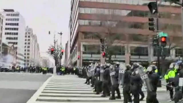 Riot police charge DC protesters