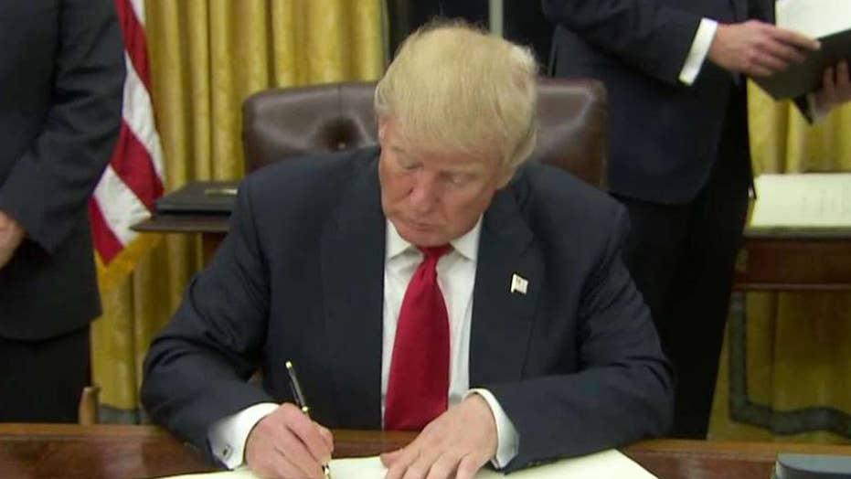 President Trump begins signing executive orders