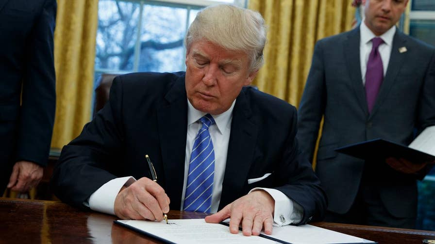 President fulfills campaign pledge on the Trans-Pacific Partnership trade deal; additionally signs order placing hiring freeze on some federal workers, reinstate ban on providing federal money to international groups that perform abortions