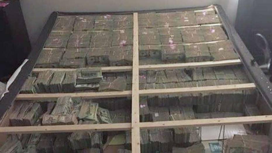 Feds seize $20 million hidden in bed