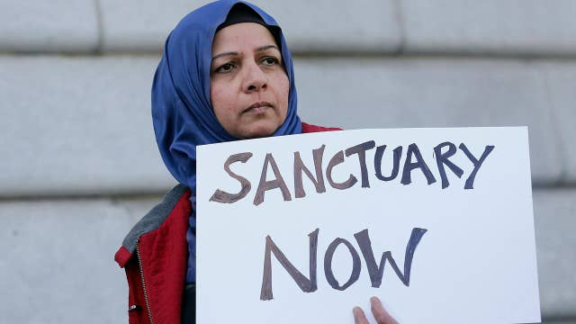 Sanctuary cities vow to defy president's executive order