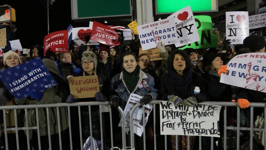 Passengers still detained at JFK airport
