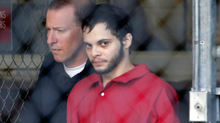 Airport massacre suspect to appear in federal court