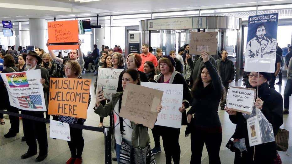 Liberals vow to defy President's immigration order