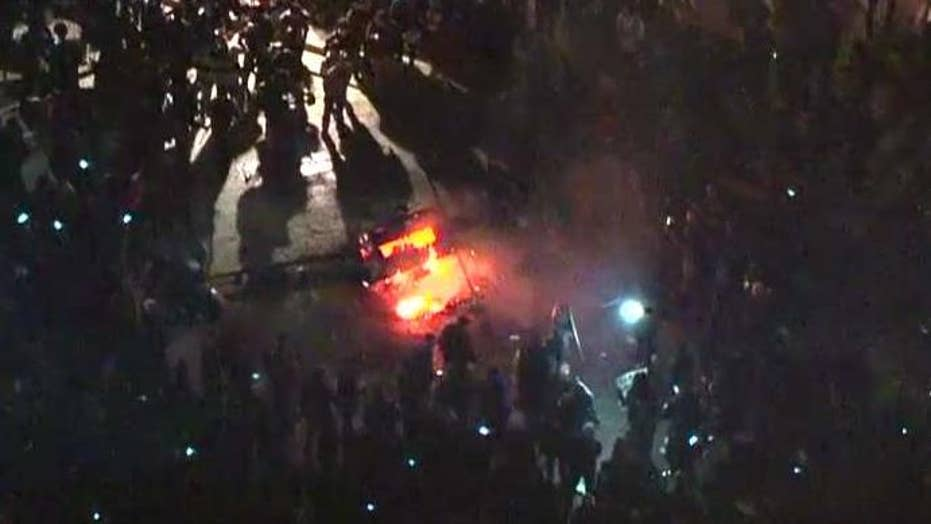 Protesters start fire over Breitbart editor speech